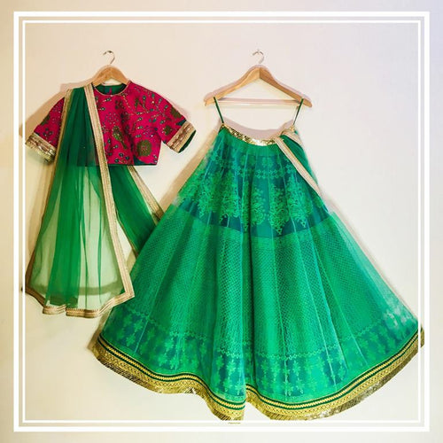 Fushia pink bird motif stone embellished choli, green brasso lehenga and green tulle dupatta