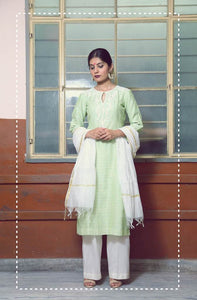 Pastel green embroidered straight kurta with ivory flare pants and kasavu dupatta