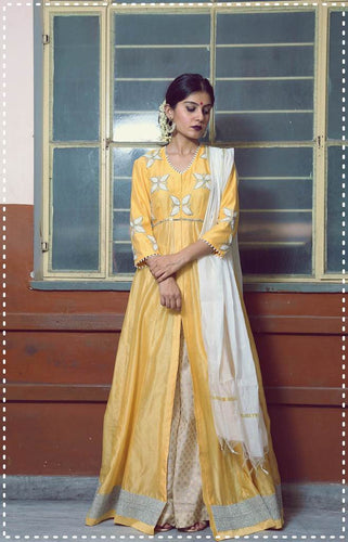 Yellow gold chanderi floor length anarkali with ivory flare pants and kasavu dupatta