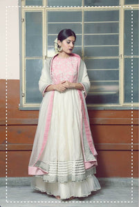Light pink and ivory chanderi floor length anarkali with ivory flare pants and tulle dupatta with golden border