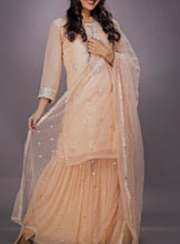 Embroidered top with Gharara and embroidered net dupatta