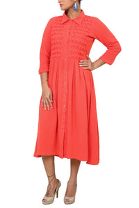 Khadi dress with hand work smocking.
