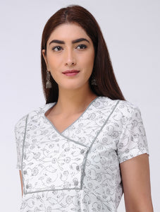 White hand block print flared short sleeve kurta with overlapping yoke in front