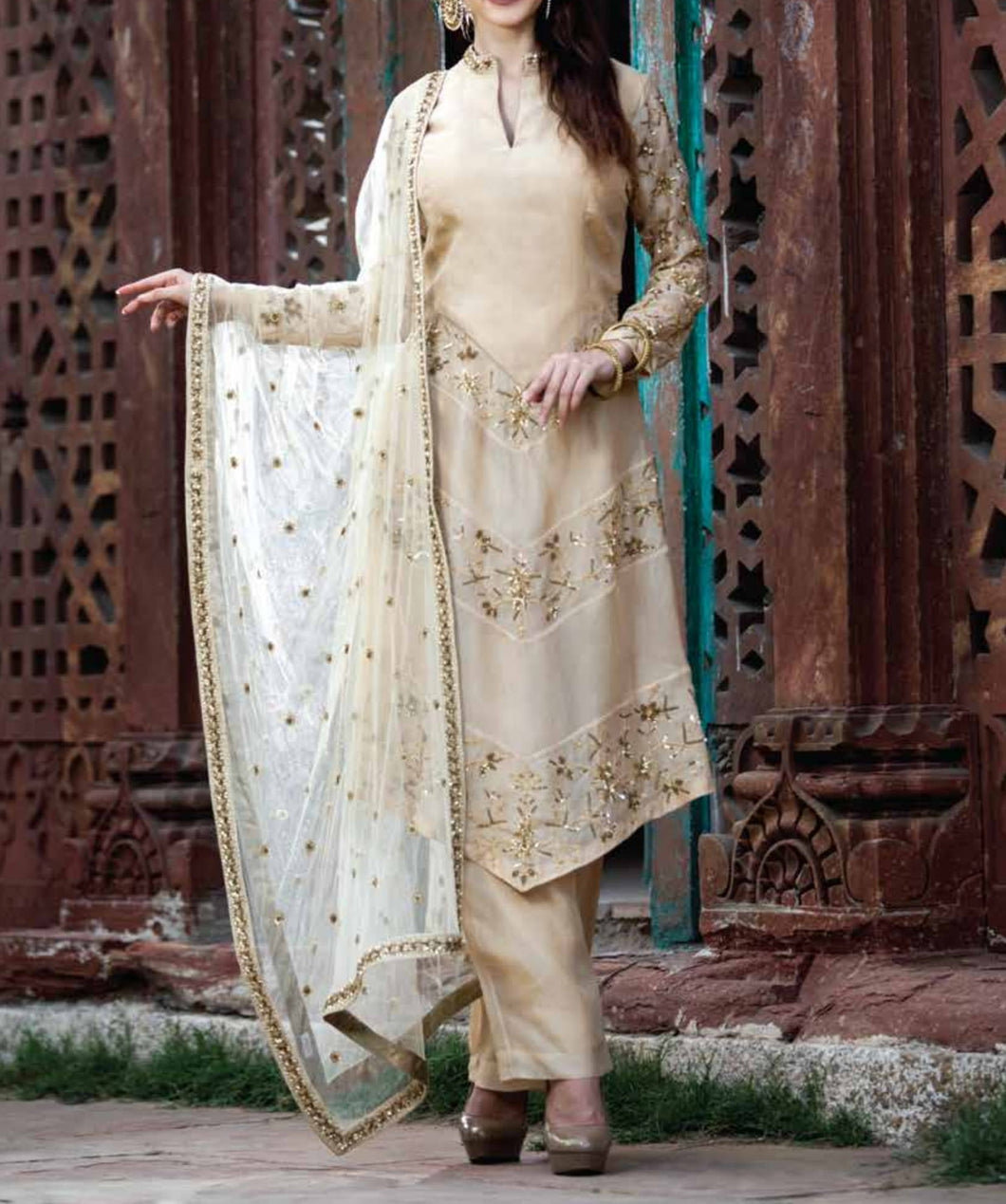 Beige embroidered suit with embroidered dupatta and pants.
