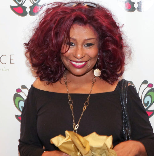Chaka Kahn at the 2014 academy awards oscars party with a babyface skin care gift bag