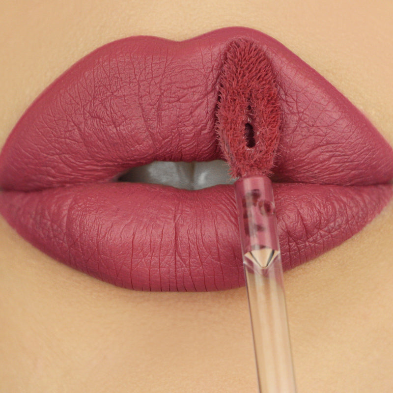 closeup of lips in warm rose liquid lipstick color