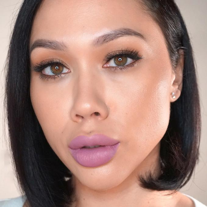 woman selfie wearing lilac shade of lipstick