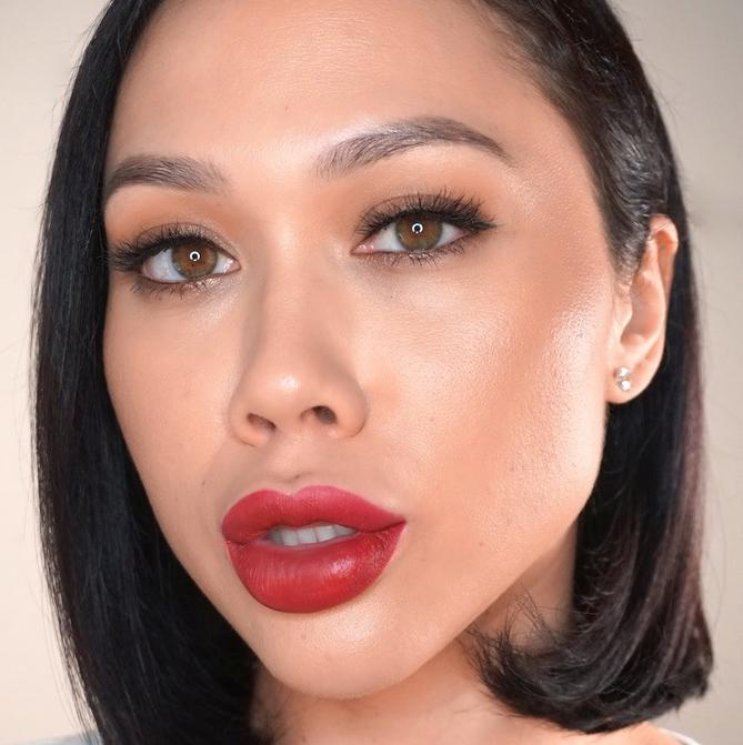 woman in bold red liquid lipstick