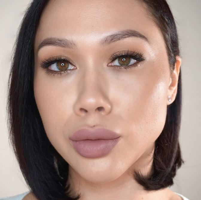 woman in neutral makeup with mauve lip
