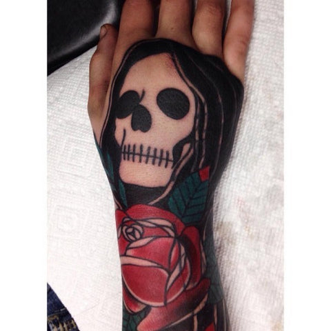 Skull and skeleton tattoo on hands