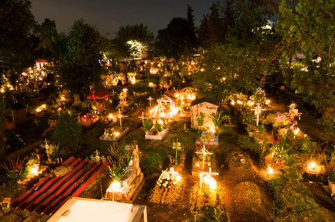 Graveyard is decorated with flowers and candles for the day of the dead