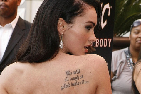 "<img src=""meme tattoo.jpg"" alt="" a meme tattoo on Meghan Fox with lines from King Leah"">"