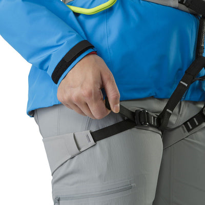 ArcTeryx AR-385a Womens Harness shown on model, with adjustable leg straps being altered