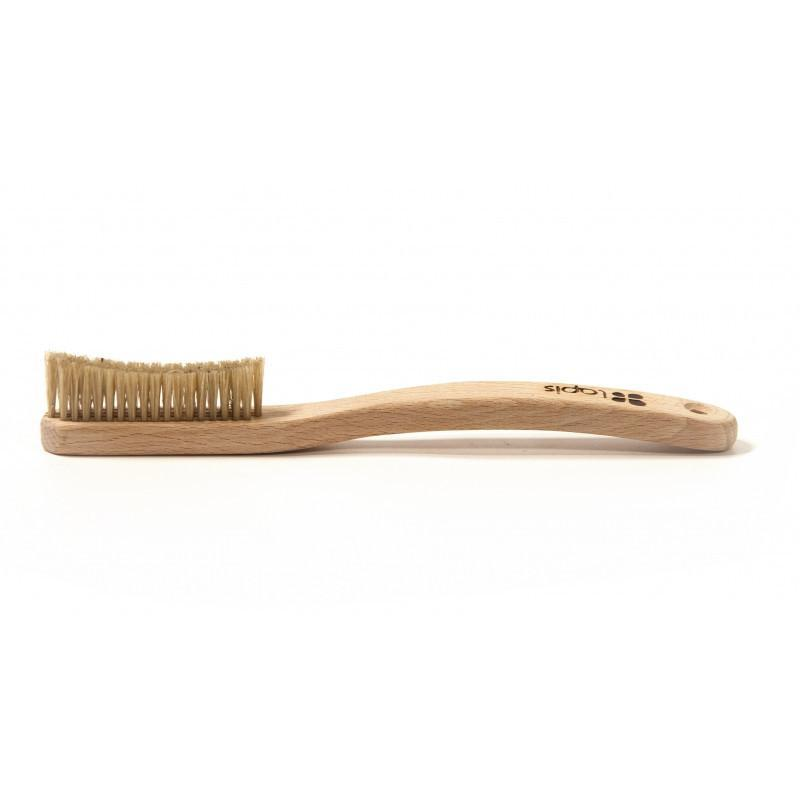 Lapis Wooden bouldering Brush, shown laid flat on white surface