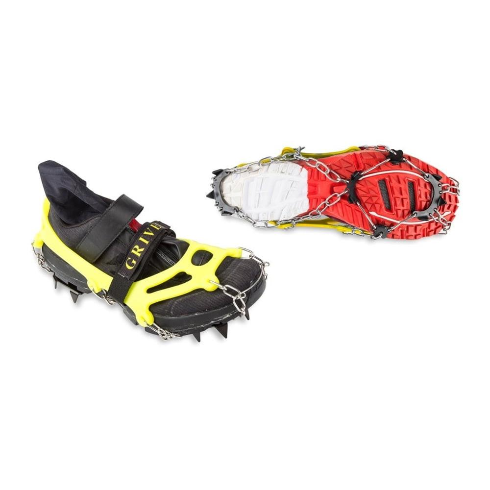 Grivel Ran Light Anti Slip spikes, shown as a pair, one on a shoe, one showing the sole. In yellow.
