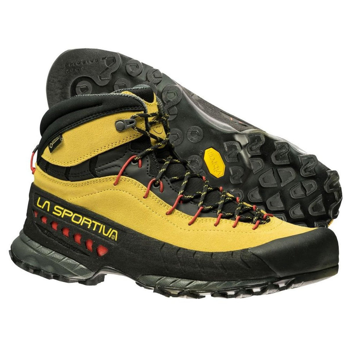 Pair of La Sportiva TX4 Mid GTX approach shoes, one showing the sole, one showing outer side
