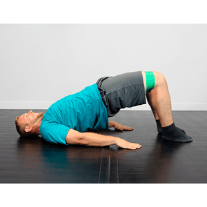 "men using the CanDo Band Exercise Loop - 15"" Long green medium"