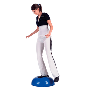 "woman using the CanDo Core-Training Vestibular Dome (21"") with Resistance Cords"