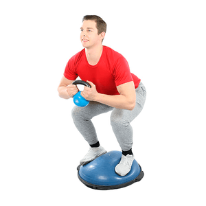"man using the CanDo Core-Training Vestibular Dome (21"") with Resistance Cords"