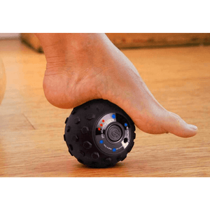 person using the LifePro 4-Speed Vibrating Massage Ball on the feet