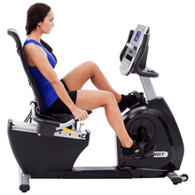 Load image into Gallery viewer, woman using the Spirit XBR95 Semi-Recumbent Bike