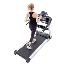 Load image into Gallery viewer, woman using the Spirit XT685 Treadmill