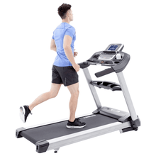 Load image into Gallery viewer, men using the Spirit XT685 Treadmill
