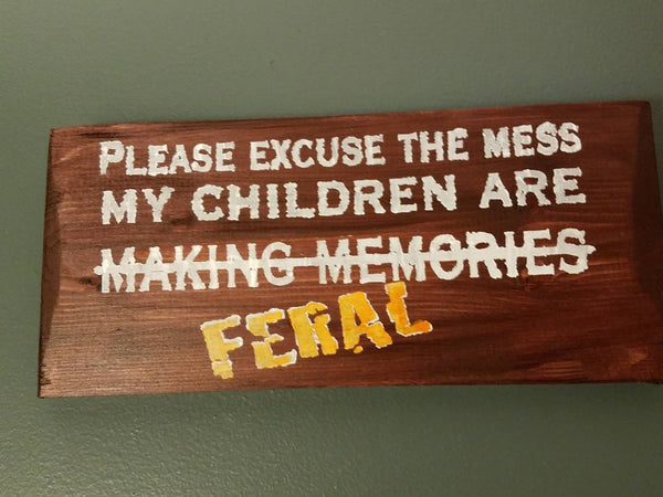 Please excuse the mess. My children are (making memories) FERAL hand-painted wood sign