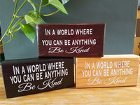 In a world where you can be anything be kind / hand-painted wood sign with vinyl letters