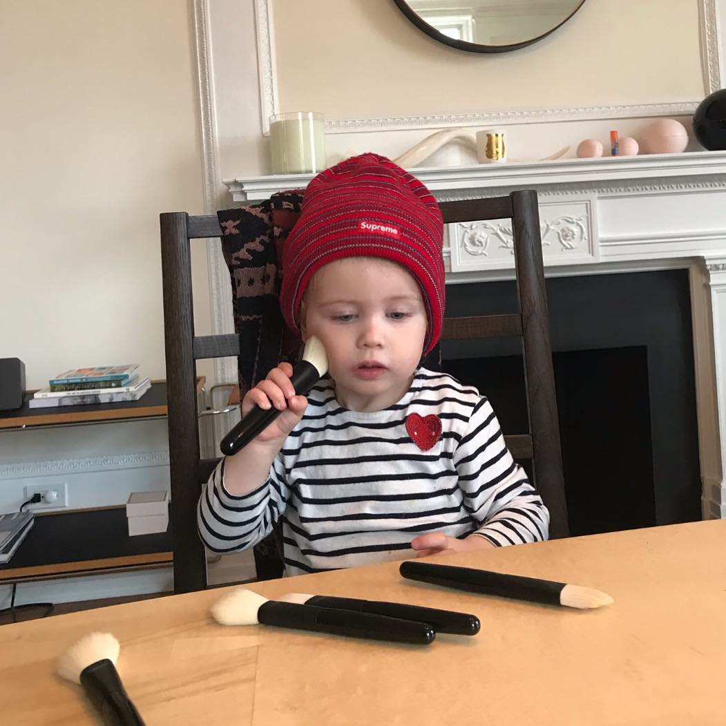 Gucci's daughter Petal plays with makeup brushes at the dining table