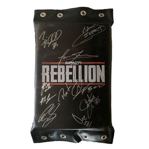 Rebellion Turnbuckle - SIGNED & NUMBERED