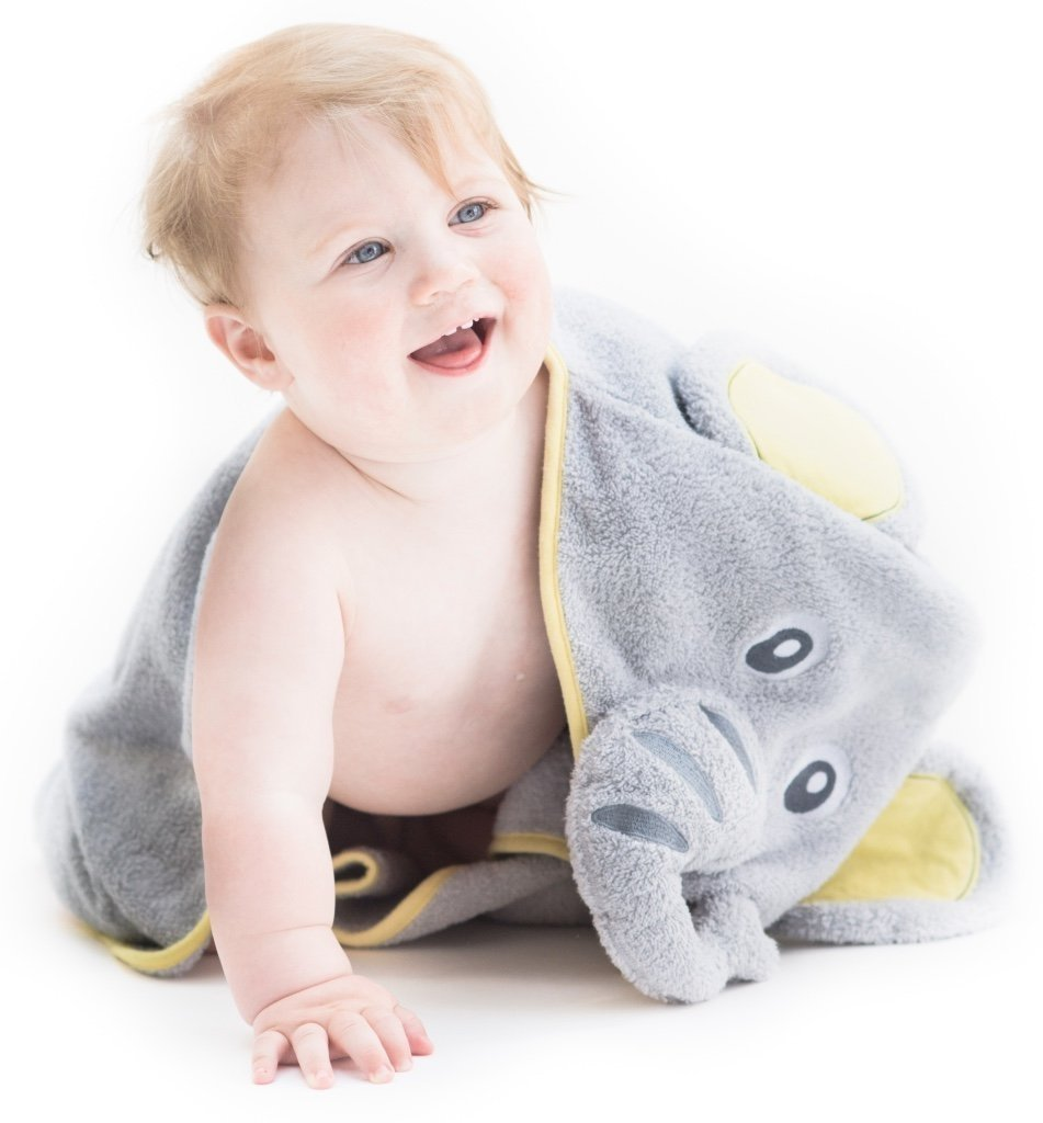 Alt = Smiling baby facing forward wearing hooded towel with elephant hood draped over shoulder