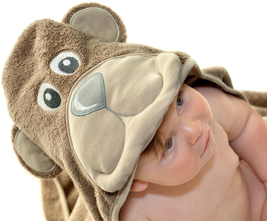 ALT = Baby looking upwards wrapped in Bear hooded towel