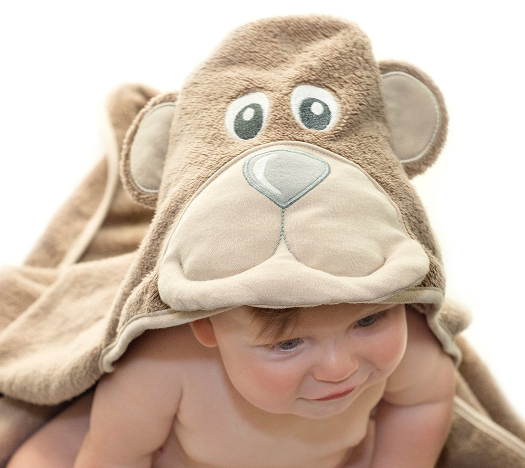 ALT = Baby leaning forward wearing Bear hooded towel
