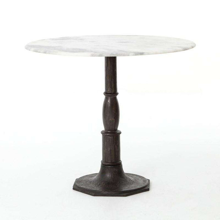 French-industrial meets bistro table. Detailed, 8-sided cast iron pedestal supports a dramatic white marble top with bull-nosed edge.