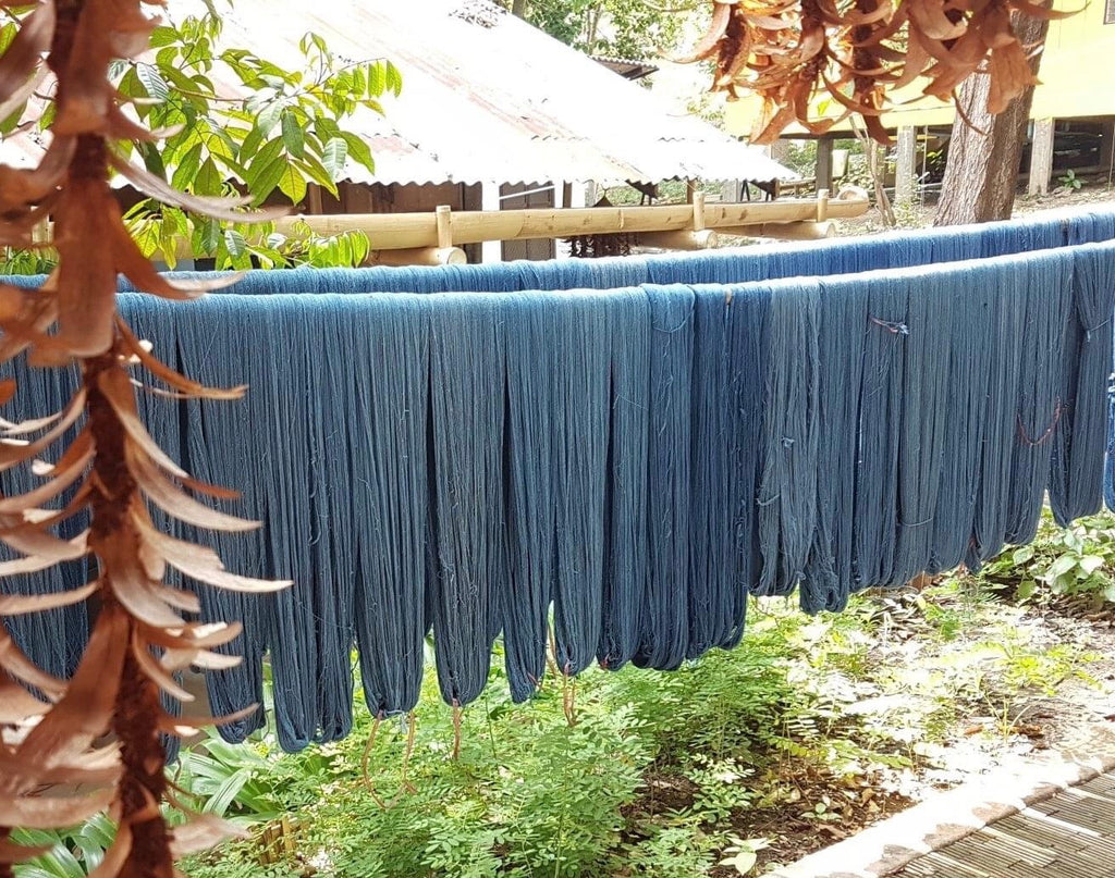 Yarn naturally-dyed by indigo hanging to dry