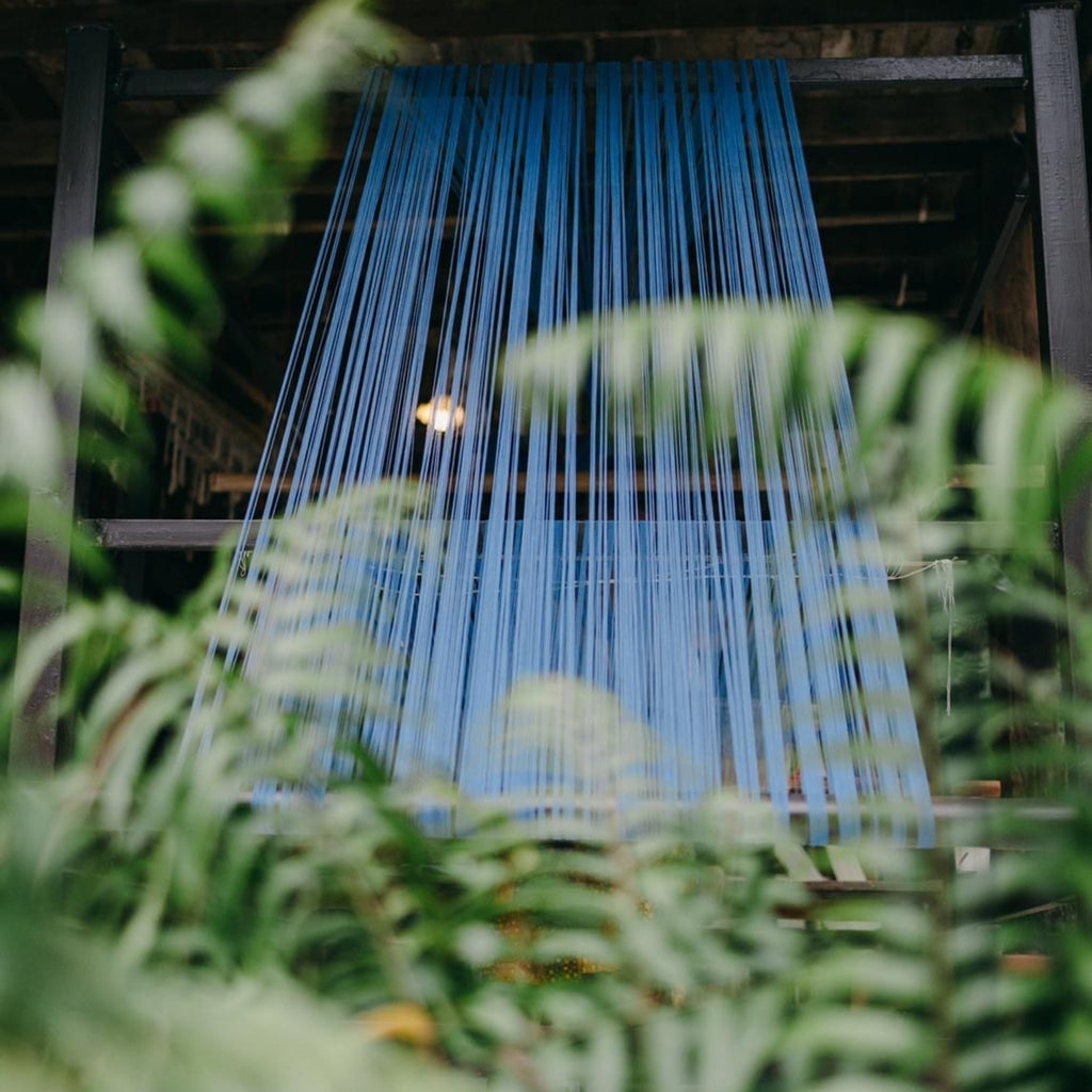 Image of the warp threads on a wooden loom