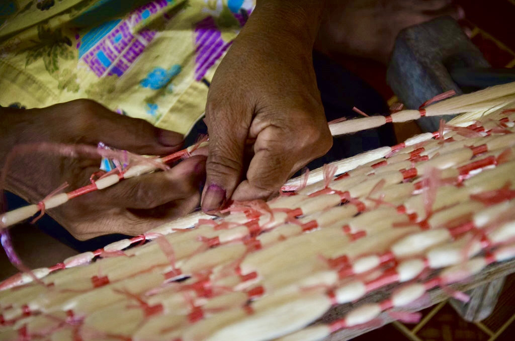 Tying the pure silk thread ready for ikat dying