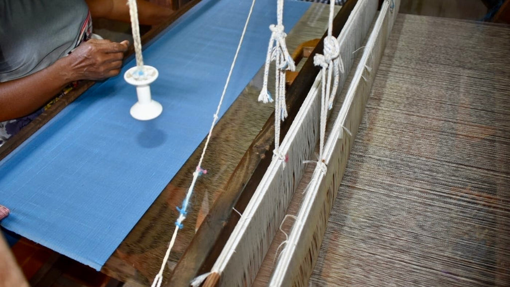 Creating the pure silk fabric for the Dawn Co Ord Set on a traditional loom. The silk production uses hand-spun silk thread.