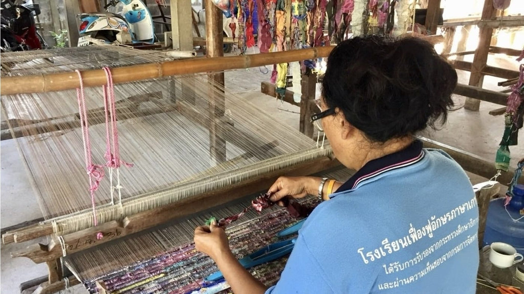 An artisan creating the 100% pure silk trim from upcycled silk yarn remnants for The Tara Midi Dress by Rare & Fair.