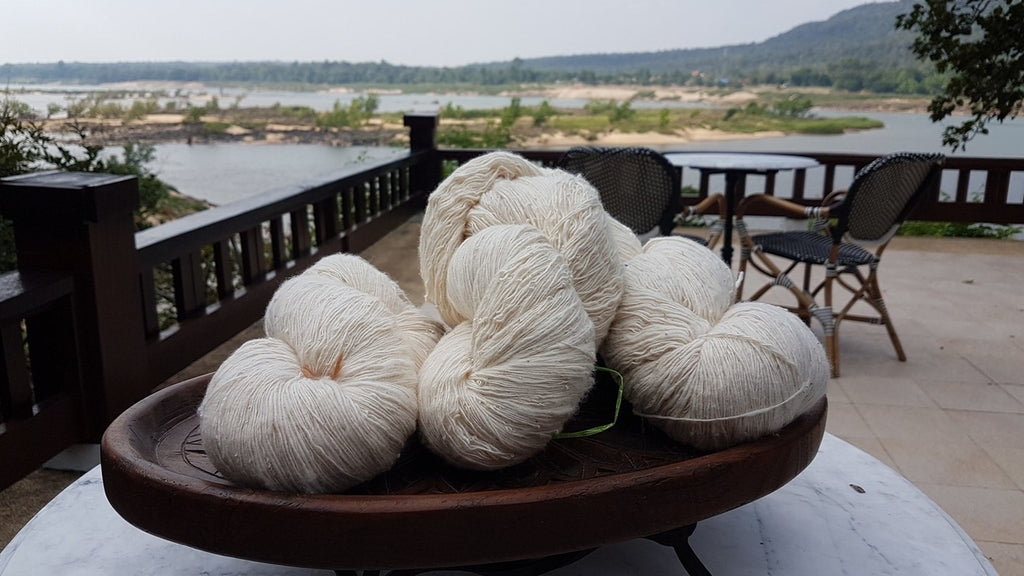 Yarn balls of undyed naturally grown sustainable cotton - Tohsang Cotton Village