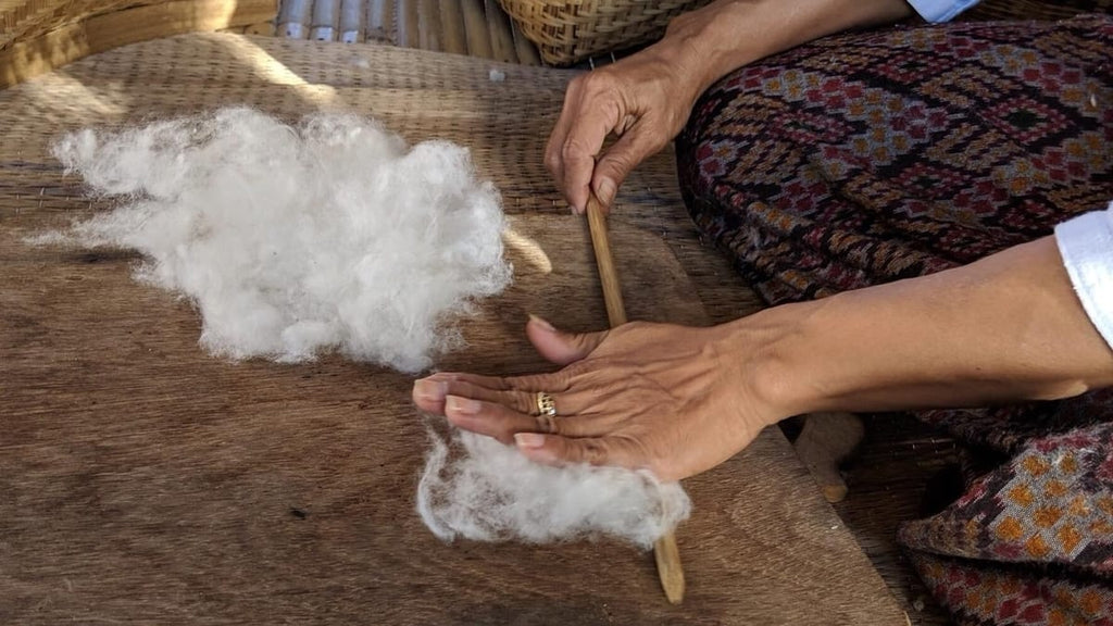 An artisan from Tohsang Cotton Village preparing the naturally-grown sustainable cotton for hand-spinning.