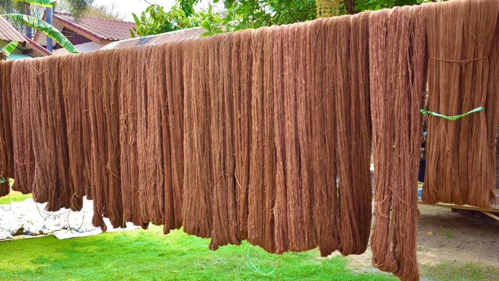 handspun sustainable cotton yarn drying after the naturally dyeing process ready to be handwoven for The Chloe Blazer Dress.