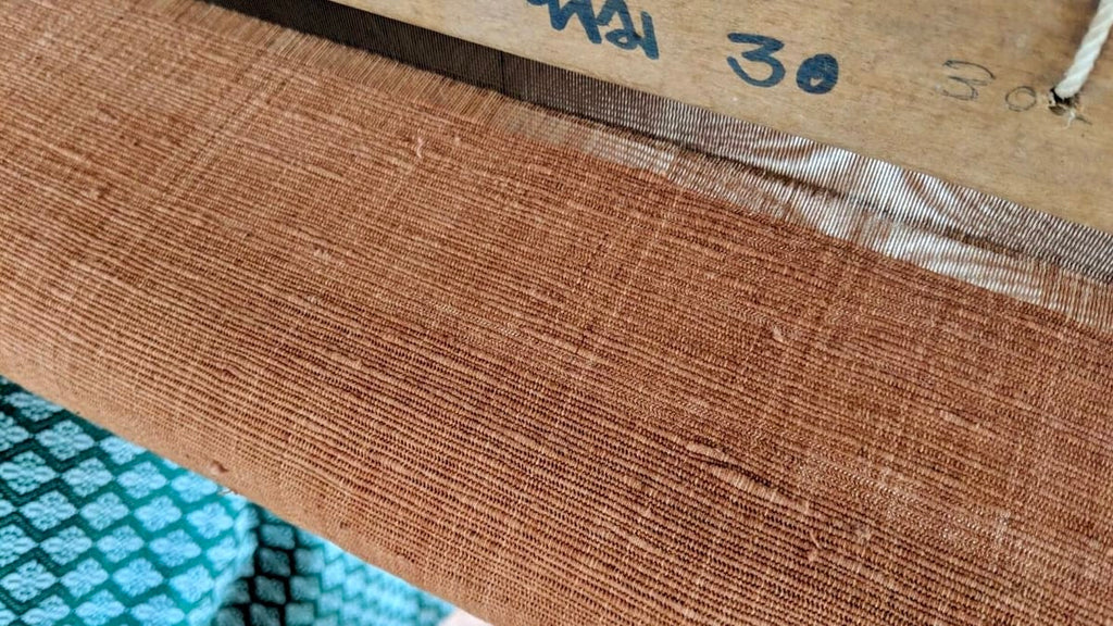 Image showing the hand-spun sustainable cotton being woven on the loom for The Chloe Blazer Dress.