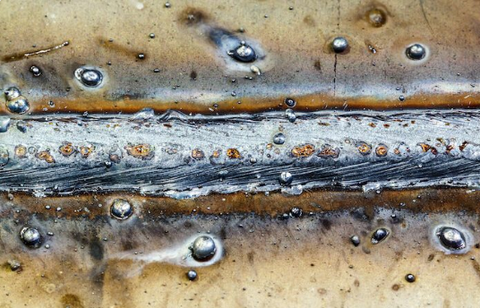 Spatter is a common defect that leaves a sloppy weld appearance.