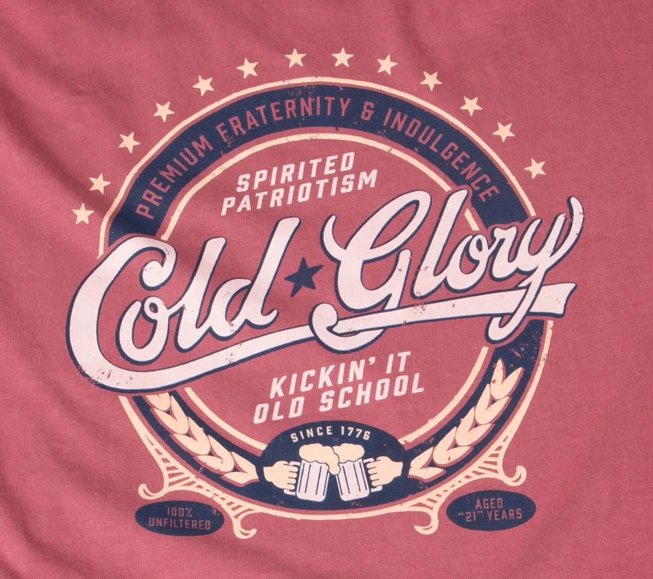 Close-up of vintage red t-shirt showing spirited patriotism, fraternity and indulgence beer label design for the Cold Glory Brand Circle design with stars and beer mugs toasting