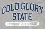Close-up of grey and blue Collegiate Varsity T-shirt. Distressed printing of college or university  name and Drinking and Thinking sport.