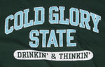 Close-up of forest green and light blue Collegiate Varsity T-shirt. Distressed printing of college or university  name and Drinking and Thinking sport.