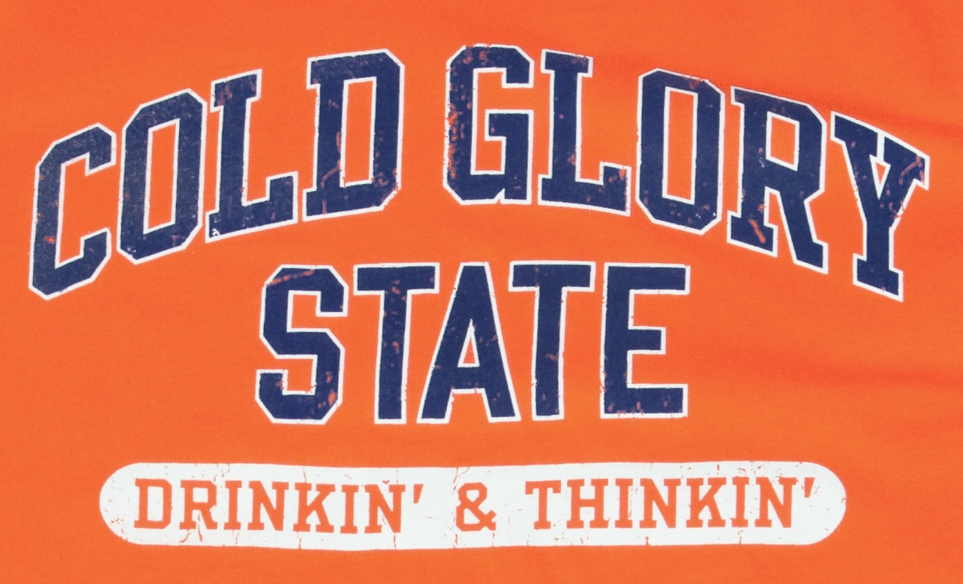 Close-up of Orange and Blue Collegiate Varsity T-shirt. Distressed printing of college or university  name and Drinking and Thinking sport.