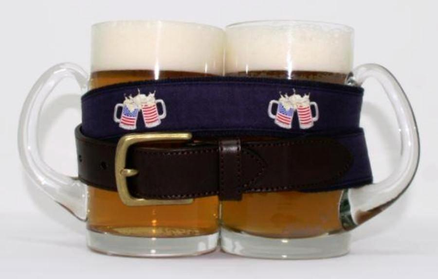 Preppy patriotic beer mugs with american flags drinking belt, with brass buckle similar to Vineyard Vines, wrapped around 2 full glass beer mugs.